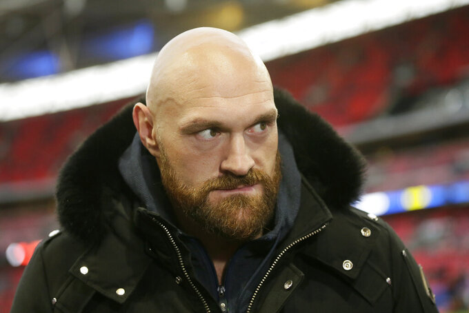 Boxer Tyson Fury is shown before an NFL football game between the Los Angeles Rams and the Cincinnati Bengals, Sunday, Oct. 27, 2019, at Wembley Stadium in London. (AP Photo/Tim Ireland)