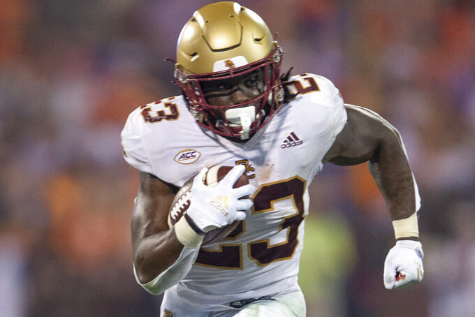 Boston College  running back Travis Levy (23) runs with the ball during the second half of an NCAA college football game against Clemson Saturday, Oct. 2, 2021, in Clemson, S.C. (AP Photo/Hakim Wright Sr.)