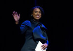 FILE - In this Jan. 3, 2019, file photo, Rep. Ayanna Pressley, D-Mass., waves to the audience during swearing-in ceremony of Congressional Black Caucus members of the 116th Congress at The Warner Theatre in Washington. A dozen times, Pressley asked the witness for a yes or no answer on housing policy. Not once did Ben Carson, President Donald Trump's housing secretary, give her one. It was a smaller pop in the epic struggle over who's in charge in Washington these days, reflecting the dynamics crackling high and low across the battlefield of divided American government. (AP Photo/Jose Luis Magana, File)