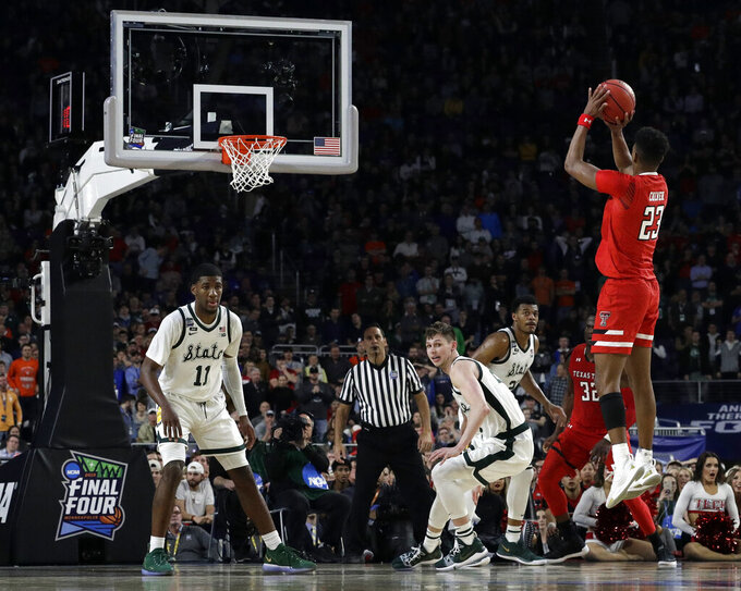Texas Tech's Jarrett Culver (23) takes a shot during the second half in the semifinals of the Final Four NCAA college basketball tournament against Michigan State, Saturday, April 6, 2019, in Minneapolis. (AP Photo/David J. Phillip)
