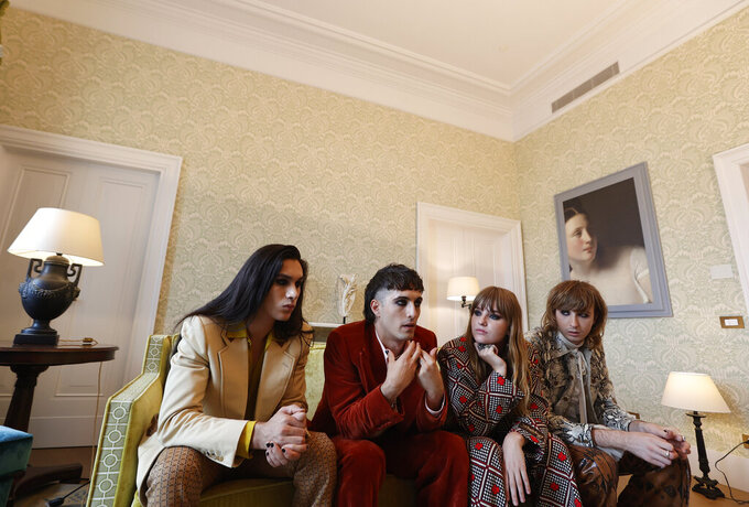 Members of the Italian band Maneskin, from left, Ethan Torchio, Damiano David, Victoria De Angelis and Thomas Raggi winners of the Eurovision Song Contest in May, are interviewd by the Associated Press at a hotel in Rome, Tuesday, July 27, 2021. (AP Photo/Riccardo De Luca)