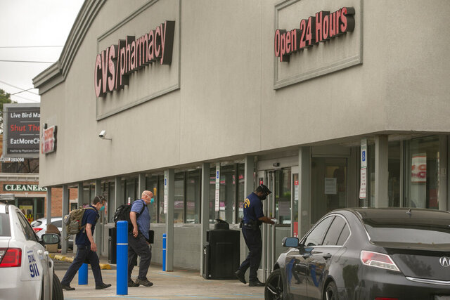Police officers enter a CVS store during an investigation into the shooting of off-duty police officer Robert Friel, Friday, May 29, 2020, in Philadelphia. (Alejandro A. Alvarez/The Philadelphia Inquirer via AP)
