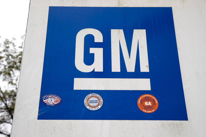 FILE - This Oct. 16, 2019, file photo shows a sign at a General Motors facility in Langhorne, Pa.  U.S. auto safety investigators have found no apparent defect with the passenger air bag seat sensors in thousands of older General Motors sedans. The National Highway Traffic Safety Administration denied a 2013 petition filed by a private crash investigator seeking a formal investigation of full-size cars including the Chevrolet Impala from the 2004 to 2010 model years.  (AP Photo/Matt Rourke, File)