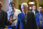 Senate Minority Leader Mitch McConnell, R-Ky., walks to his office as reporters ask about the infrastructure deal reached among Senate Democrats last night, at the Capitol in Washington, Wednesday, July 14, 2021. (AP Photo/J. Scott Applewhite)