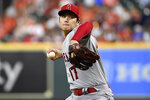 Los Angeles Angels starting pitcher Shohei Ohtani delivers during the first inning of a baseball game against the Houston Astros, Friday, Sept. 10, 2021, in Houston. (AP Photo/Eric Christian Smith)
