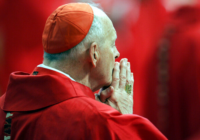 FILE - In this Monday, April 18, 2005 file photo, U.S. Cardinal Theodore Edgar McCarrick attends a Mass in St. Peter's Basilica at the Vatican. On Saturday, Feb. 16, 2019 the Vatican announced Pope Francis defrocked former U.S. Cardinal Theodore McCarrick after Vatican officials found him guilty of soliciting for sex while hearing Confession.  (AP Photo/Pier Paolo Cito, files)