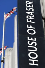 The logo of the House of Fraser department store on Oxford Street in London, Friday, Aug. 10, 2018.  British retailer Sports Direct said Friday that it has bought struggling department store chain House of Fraser, just hours after the 169-year-old business went into administration.  (AP Photo/Frank Augstein)