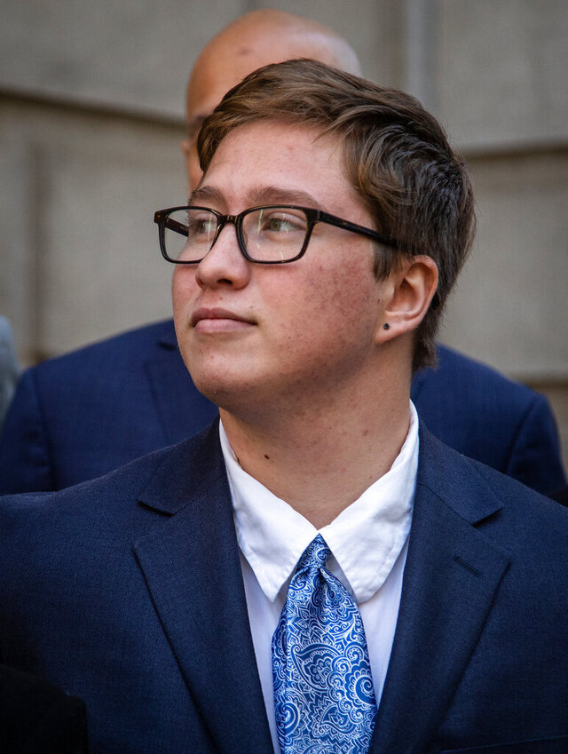Transgender student Drew Adams stands outside of the 11th Circuit Court of Appeals on Thursday, Dec. 5, 2019, in Atlanta.  A federal appeals court said Monday, Aug. 10, 2020, that a Florida school district was wrong when it forced a transgender student to either use a girls or gender neutral bathroom even though he identified as a boy. (AP Photo/ Ron Harris)