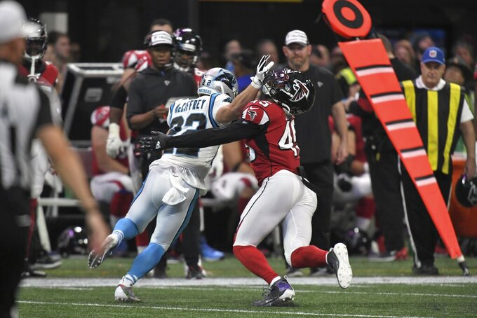 Carolina Panthers running back Christian McCaffrey (22) hits Atlanta Falcons linebacker Deion Jones (45) during the second half of an NFL football game, Sunday, Dec. 8, 2019, in Atlanta. (AP Photo/Danny Karnik)