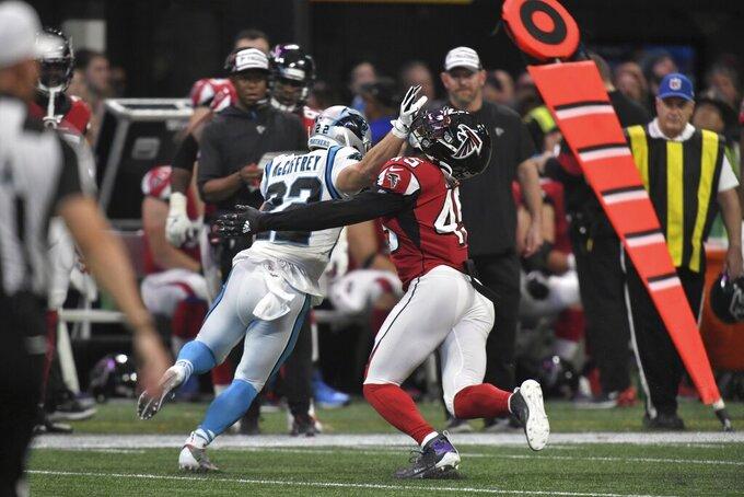 Carolina Panthers running back Christian McCaffrey (22) hits Atlanta Falcons linebacker Deion Jones (45) during the second half of an NFL football game, Sunday, Dec. 8, 2019, in Atlanta. (AP Photo/Danny Karnik)