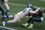 FILE - Los Angeles Rams defensive lineman Aaron Donald sacks Seattle Seahawks quarterback Russell Wilson during the second half of an NFL football game in Seattle, in this Sunday, Dec. 27, 2020, file photo. Donald was selected Friday, Jan. 8, 2021, to The Associated Press All-Pro Team. (AP Photo/Stephen Brashear, File)