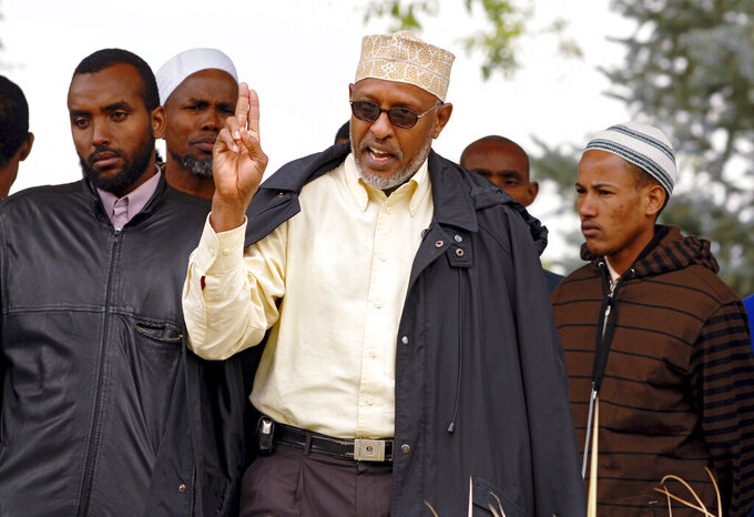 FILE - In this Sept. 9, 2008, file photo, Abdullahi Abdirahman, a Somali community leader in Greeley, Colo. speaks to Muslims employed at JBS Swift & Co. about the negotiations between the company and the workers regarding their break times during a gathering at Lincoln Park in Greeley, Colo. JBS Swift & Co., will pay up to $5.5 million to settle a lawsuit that claimed the meatpacking company discriminated against Muslim employees at its beef processing plant in northern Colorado. The U.S. Equal Employment Opportunity Commission filed the lawsuit in federal court in Denver in 2010, saying JBS discriminated against employees at its plant in Greeley by denying them bathroom breaks and disciplining them more harshly than other workers because they were Muslim, immigrants from Somalia and Black. JBS must pay the $5.5 million to about 300 employees who were included in the settlement announced Wednesday, June 9, 2021. (Sara Loven/The Greeley Tribune via AP, File)