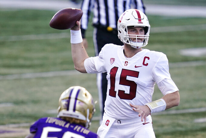 Stanford quarterback Davis Mills throws against Washington in the first half of an NCAA college football game Saturday, Dec. 5, 2020, in Seattle. (AP Photo/Elaine Thompson)