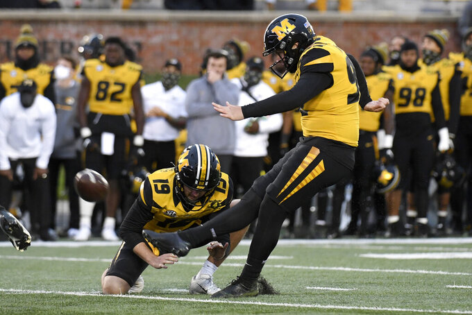 Missouri place kicker Harrison Mevis kicks a 20-yard field goal as Grant McKinniss (19) holds during the second half of an NCAA college football game against Kentucky Saturday, Oct. 24, 2020, in Columbia, Mo. Missouri won the game 20-10. (AP Photo/L.G. Patterson)