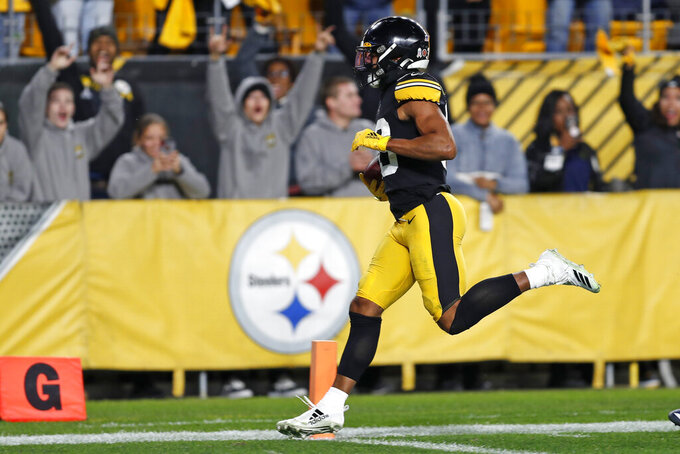 Pittsburgh Steelers free safety Minkah Fitzpatrick (39) crosses the goal line for a touchdown after recovering a fumble by Los Angeles Rams quarterback Jared Goff during the first half of an NFL football game in Pittsburgh, Sunday, Nov. 10, 2019. (AP Photo/Keith Srakocic)