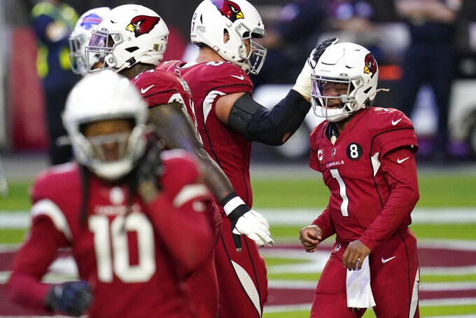 Arizona Cardinals quarterback Kyler Murray (1) celebrates his rushing touchdown against the Buffalo Bills during the second half of an NFL football game, Sunday, Nov. 15, 2020, in Glendale, Ariz. (AP Photo/Ross D. Franklin)
