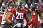 FILE - In this Nov. 23, 2019, file photo, Washington State defensive back Bryce Beekman (26) is greeted by defensive lineman Nnamdi Oguayo (30) and linebacker Jahad Woods (13) after Beekman intercepted an Oregon State pass during the first half of an NCAA college football game in Pullman, Wash. Bryce Beekman has died. Police Cmdr. Jake Opgenorth said Wednesday, Marc 25, 2020, the 22-year-old Beekman was found dead at a residence in Pullman. He declined to provide additional details and said more information would be released later by the Whitman County coroner's office. (AP Photo/Ted S. Warren, File)