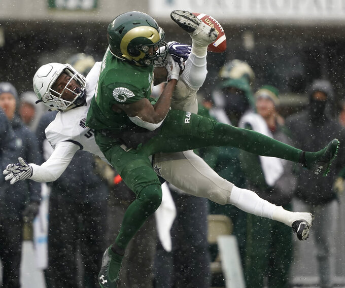 Utah State cornerback DJ Williams, left, breaks up a pass intended for Colorado State wide receiver Preston Williams during the second half of an NCAA football game Saturday, Nov. 17, 2018, in Fort Collins, Colo. Fogal was called for pass interference on the play. (AP Photo/Jack Dempsey)