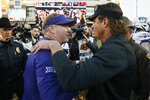 TCU head coach Gary Patterson, left, and Oklahoma State head coach Mike Gundy, right, talk following their NCAA college football game in Stillwater, Okla., Saturday, Nov. 2, 2019. (AP Photo/Sue Ogrocki)