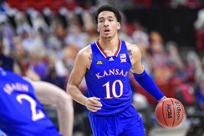 Kansas' Jalen Wilson (10) controls the ball during the first half of an NCAA college basketball game against Texas Tech in Lubbock, Texas, Thursday, Dec. 17, 2020. (AP Photo/Justin Rex)