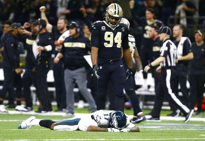 FILE - In this Sunday, Jan. 13, 2019, file photo, Philadelphia Eagles wide receiver Alshon Jeffery (17) lies on the turf in front of New Orleans Saints defensive end Cameron Jordan (94) after the Saints intercepted a pass in the second half of an NFL divisional playoff football game in New Orleans. The Saints defense will take on one of the NFL's best offenses in the NFC title game against the Los Angeles Rams. (AP Photo/Butch Dill, File)