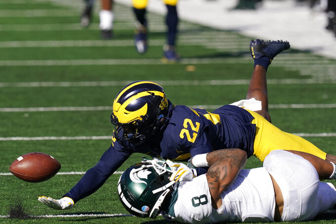 Michigan defensive back Gemon Green (22) knocks the ball away from Michigan State wide receiver Jalen Nailor (8) during the second half of an NCAA college football game, Saturday, Oct. 31, 2020, in Ann Arbor, Mich. (AP Photo/Carlos Osorio)