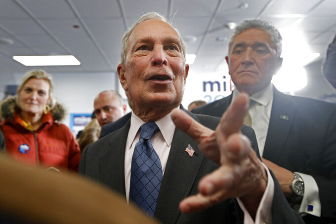 Democratic presidential candidate and former New York City Mayor Michael Bloomberg, center, greets supporters at a campaign office, Monday, Jan. 27, 2020, in Scarborough, Maine. (AP Photo/Robert F. Bukaty)