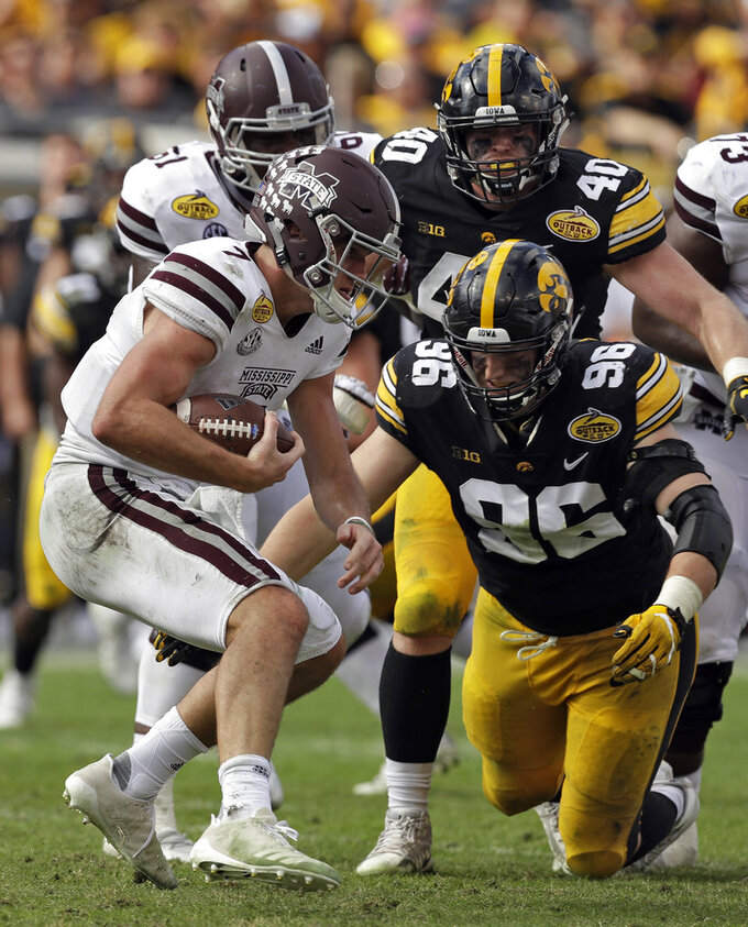 Mississippi State quarterback Nick Fitzgerald (7) gets stopped by Iowa defensive end Matt Nelson (96) during the second half of the Outback Bowl NCAA college football game Tuesday, Jan. 1, 2019, in Tampa, Fla. (AP Photo/Chris O'Meara)