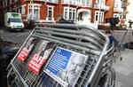 Placards on a crowd barriers outside the Ecuadorian Embassy in London, Friday, April 5, 2019, where Wikileaks founder Julian Assange has been holed up since 2012. A senior Ecuadorian official said no decision has been made to expel Julian Assange from the country's London embassy despite tweets from Wikileaks that sources had told it he could be kicked out within