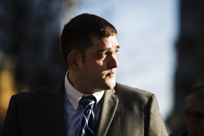 Former East Pittsburgh police officer Michael Rosfeld, charged with homicide in the shooting death of Antwon Rose II, arrives at the Dauphin County Courthouse in Harrisburg, Pa., Tuesday, March 12, 2019. (AP Photo/Matt Rourke)