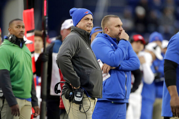 SMU head coach Sonny Dykes looks on during the first half of an NCAA college football game against Navy, Saturday, Nov. 23, 2019, in Annapolis, Md. (AP Photo/Julio Cortez)