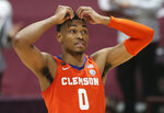 Clemson's Clyde Trapp 0 reacts to a missed scoring opportunity in the second half of an NCAA  college basketball game in Blacksburg Va., Tuesday, Dec. 15, 2020.  (Matt Gentry/The Roanoke Times via AP, Pool)