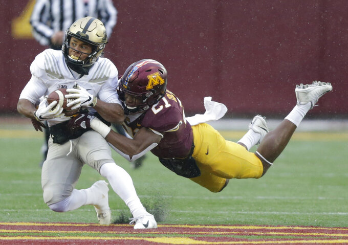 Purdue running back D.J. Knox (1) is tackled by Minnesota defensive back Jamal Martin (21) in the first quarter against Minnesota in a NCAA college football game Saturday, Nov. 10, 2018, in Minneapolis. (AP Photo/Andy Clayton-King)