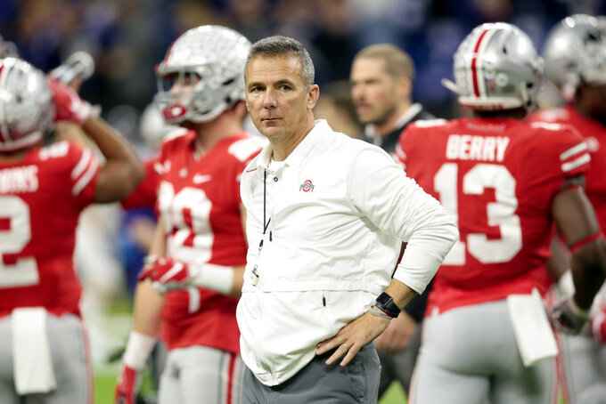 Ohio State head coach Urban Meyer watches during his team warm up before the Big Ten championship NCAA college football game against Northwestern, Saturday, Dec. 1, 2018, in Indianapolis. (AP Photo/AJ Mast)