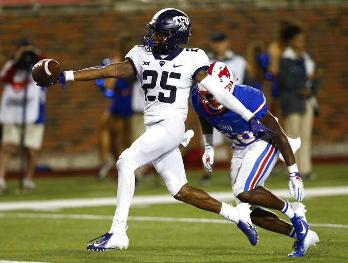 FILE - In this Sept. 7, 2018, file photo, TCU wide receiver KaVontae Turpin (25) scores a touchdown after a catch against SMU during the fourth quarter of an NCAA college football, in Dallas. TCU receiver and standout returner KaVontae Turpin has been dismissed from the team after a second similar charge surfaced following his weekend arrest on an assault charge for an alleged altercation with his girlfriend. Coach Gary Patterson said Tuesday, Oct. 23, 2018, that Turpin will no longer be allowed to be on the team.(AP Photo/Jim Cowsert, File)