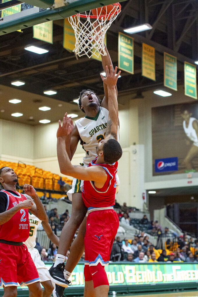 Norfolk State forward Alex Long drives in for a layup against Delaware State's Jon Mitchell during the first half of an NCAA college basketball game, Saturday, Jan. 5, 2019, in Norfolk, Va. (Mike Caudill/The Virginian-Pilot via AP)
