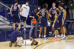 Notre Dame's Trey Wertz reacts as a team physician tends to a leg injury during the first half of the team's NCAA college basketball game against Virginia on Wednesday, Dec. 30, 2020, in South Bend, Ind. (AP Photo/Robert Franklin)