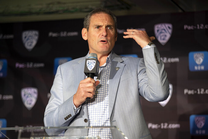FILE - In this Oct. 8, 2019, file photo, commissioner Larry Scott speaks during the Pac-12 NCAA college basketball media day, in San Francisco.  A Pac-12 team has made the College Football Playoff just twice in six seasons and none of the last three. If anyone should be leading the charge toward expanding the current four-team model, you would think it would be Pac-12 Commissioner Larry Scott. (AP Photo/D. Ross Cameron, File)