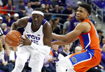 TCU forward Kouat Noi (12), of Australia, drives to the basket past Florida guard Noah Locke (10) in the second half of an NCAA college basketball game in Fort Worth, Texas, Saturday, Jan. 26, 2019. (AP Photo/Tony Gutierrez)