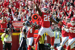 Kansas City Chiefs running back Damien Williams (26) celebrates a touchdown during the first half of an NFL football game against the Houston Texans in Kansas City, Mo., Sunday, Oct. 13, 2019. (AP Photo/Ed Zurga)