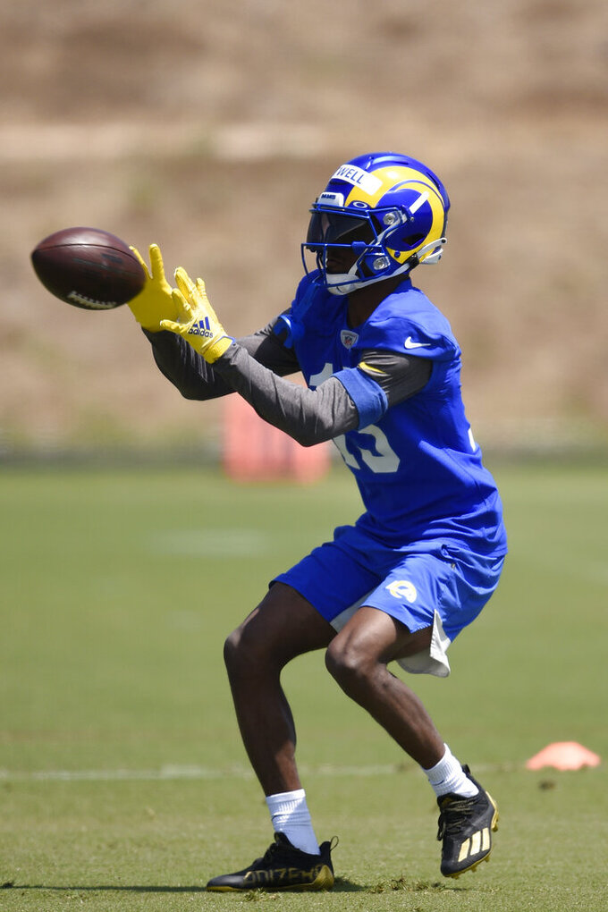 Los Angeles Rams' Tutu Atwell runs a drill during NFL football practice in Thousand Oaks, Calif., Thursday, May 27, 2021. (AP Photo/Kelvin Kuo)