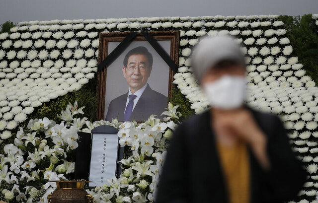A mourner passes by a memorial altar for late Seoul Mayor Park Won-soon at City Hall Plaza in Seoul, South Korea, Monday, July 13, 2020. Mayor Park was found dead in wooded hill in northern Seoul on Friday after massive police searches for him. (AP Photo/Lee Jin-man)