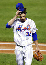 New York Mets pitcher Steven Matz reacts while walking to the dugout after being relieved during the third inning of a baseball game against the Atlanta Braves, Friday, Sept. 18, 2020, in New York. (AP Photo/Adam Hunger)