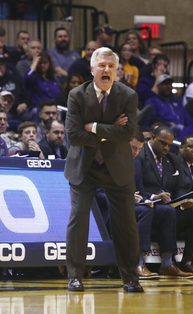 Kansas State head coach Bruce Weber yells at his players during the first half of an NCAA college basketball game against West Virginia Monday, Feb. 18, 2019, in Morgantown, W.Va. (AP Photo/Raymond Thompson)