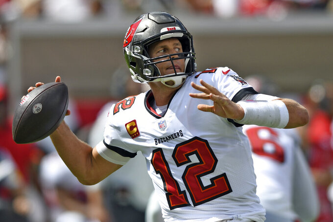 Tampa Bay Buccaneers quarterback Tom Brady (12) throws a pass against the Miami Dolphins during the first half of an NFL football game Sunday, Oct. 10, 2021, in Tampa, Fla. (AP Photo/Jason Behnken)
