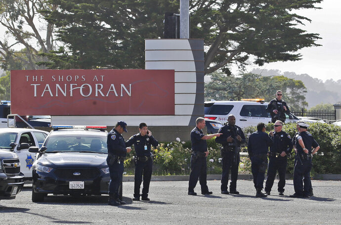 Police investigate at the scene of a shooting at the Tanforan Mall in San Bruno, Calif., Tuesday, July 2, 2019. Police are searching for suspects after at least two people were wounded in a mall shooting near San Francisco on Tuesday that led to region-wide transit delays at rush hour. (AP Photo/Stephanie Mullen)