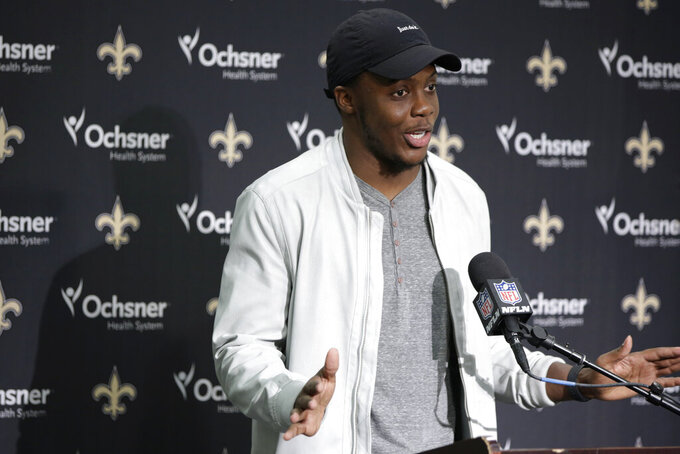 New Orleans Saints quarterback Teddy Bridgewater talks to reporters during a news conference following NFL football game against the Seattle Seahawks, Sunday, Sept. 22, 2019, in Seattle. (AP Photo/Scott Eklund)