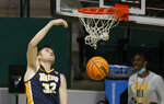 Toledo forward JT Shumate dunks against Richmond during the second half of an NCAA college basketball game in the first round of the NIT, Wednesday, March 17, 2021, in Denton, Texas. (AP Photo/Ron Jenkins)