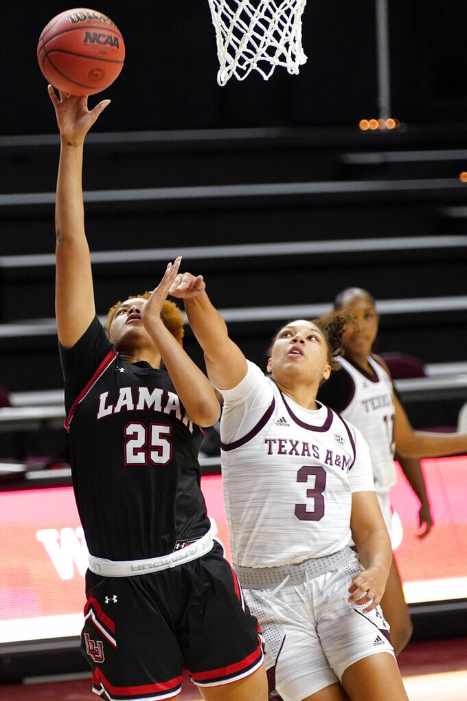 Lamar center Bebe Galloway (25) shoots past Texas A&M guard Destiny Pitts (3) during the first half of an NCAA college basketball game Wednesday, Nov. 25, 2020, in College Station, Texas. (AP Photo/Sam Craft)