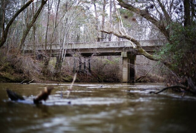 FILE- This Feb. 22, 2018, file photo shows, a bridge that spans the Apalachee River at Moore's Ford Road where in 1946 two young black couples were stopped by a white mob who dragged them to the riverbank and shot them multiple times in Monroe, Ga. A federal appeals court said Friday, March 27, 2020, that the grand jury records from the 1946 lynching of two black couples in Georgia cannot be released despite their great historical significance. (AP Photo/David Goldman, File)